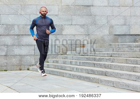 Young active man training outdoors