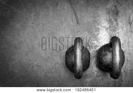 Two old kettle bell. Black and white.