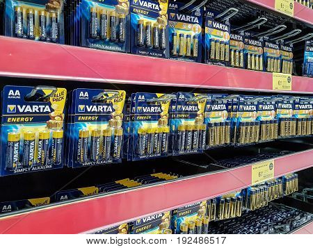 Nowy Sacz Poland - June 16 2017: Various types of Varta batteries on sale in Tesco hypermarket. VARTA AG is a famous German company manufacturing batteries.