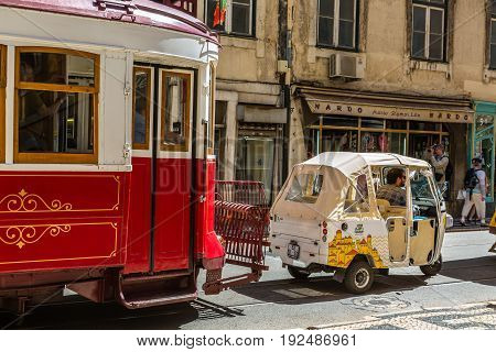 Lisbon, Portugal - May 18, 2017: The Famous Old Tram And Tuk Tuk In Lisbon