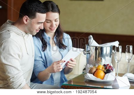 Young couple having rest in luxurious hotel