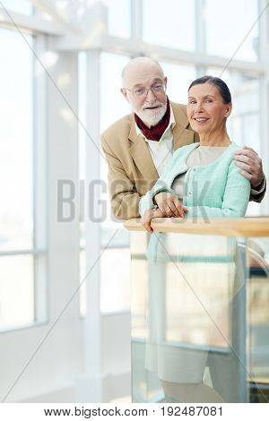 Happy and amorous seniors looking at camera