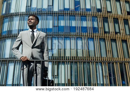 Elegant employer in suit on backgrouns of modern edifice
