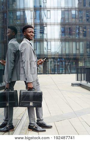 Modern businessman with briefcase in urban environment