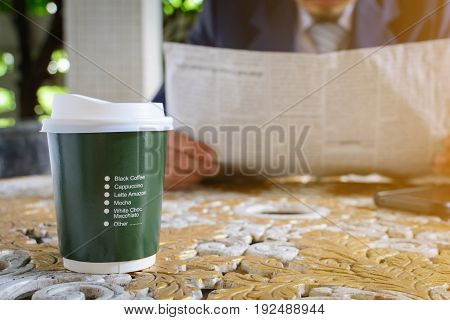 Coffee Cup Clock And Newspaper Work On Table