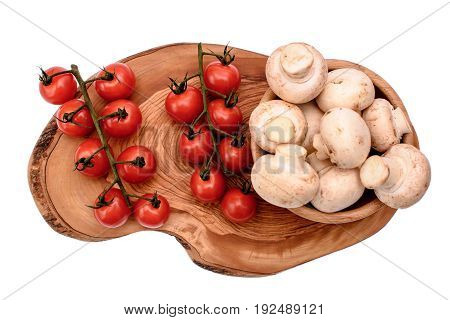 White Mushrooms Champignons And Cherry Tomatoes Lie On A Wooden Board Of Drying Oil, Isolated On Whi