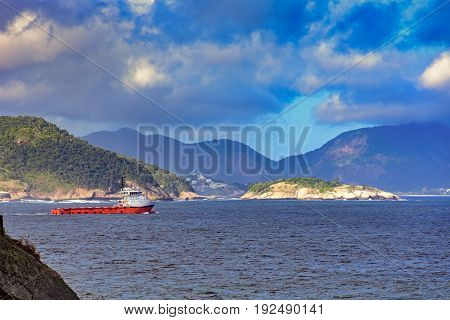 Ship sailing between islands hills and forests of Guanabara bay in Rio de Janeiro