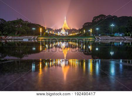 The double reflection of Shwedagon pagoda the famous landmark of Yangon township of Myanmar.