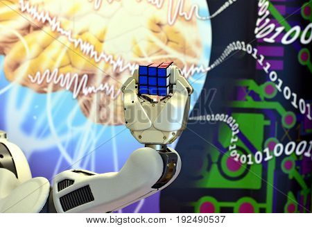 Londonderry, UK. Feb. 20. A robot holding a Rubik's Cube with the background of brain science and digital numbers at Ulster University, Feb 20. 2017, Londonderry, UK.