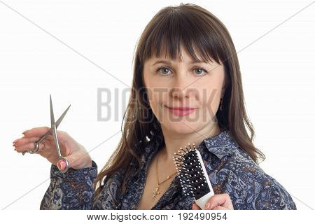pretty stylist with tool in hands posing on the camera in studio on white background