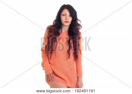lovely woman in pink sweater posing on camera isolated on white background
