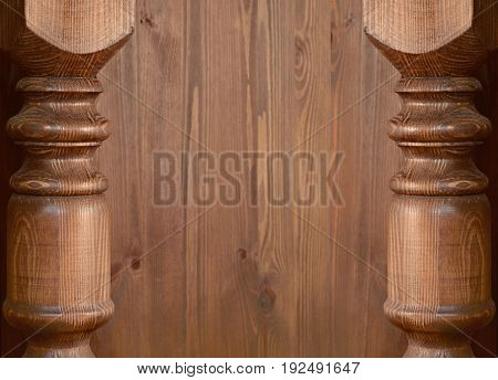 Focused carved baluster edges on soft wooden background