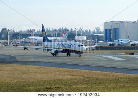 EVERETT, WASHINGTON, USA - JAN 26th, 2017: A brand new Ryanair Boeing 737-800 Next Gen MSN 44766, Registration EI-FTP returns from a successful test flight, landing at Snohomish County Airport or Paine Field.