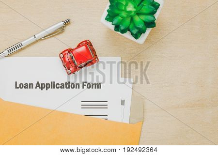 Top view business office desk background.The business loan application form pencil letter and car tree on wooden table background with copy space.