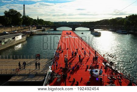 PARIS , FRANCE - JUNE 23, 2017 : The floating race installed on Seine river near Alexandre III bridge in Paris, France as part of final push to win the rights to host the 2024 Olympic games.