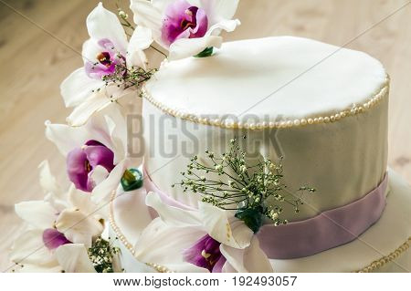 Beautiful wedding cake with flowers close up of cake with blurred background selective focus.
