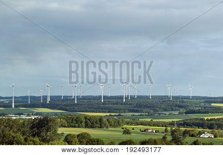 Wind turbine farm in valley in Germany - renewable sustainable and alternative energy