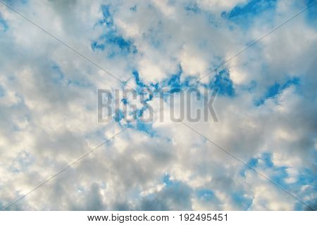 Blue sky with dramatic white clouds background.