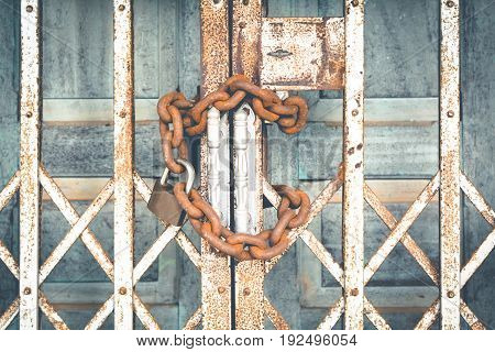 Old door with key and chains color vintage style