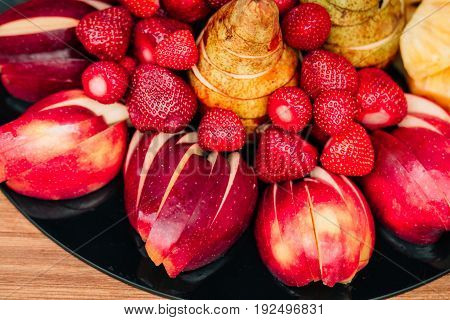 fresh fruits lie on a wooden table