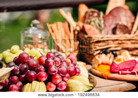 fresh grapes and apples decorate the festive table