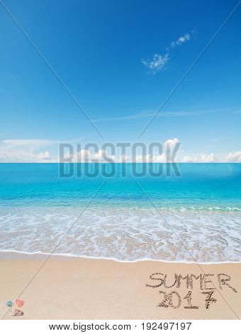 welcome to summer 2017 written on a tropical beach under clouds