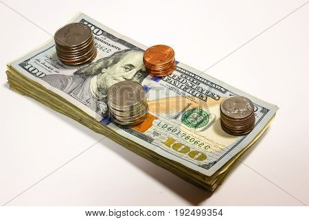 Us dollar bills and coins isolated on white background.