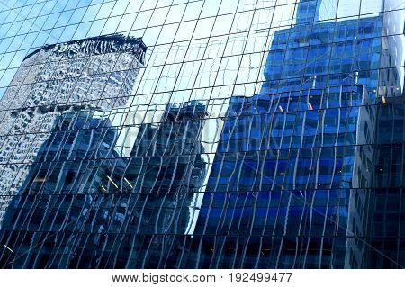 Background, a modern skyscraper with a glass facade