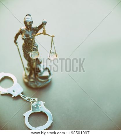 Legal law - scales of justice and handcuffs