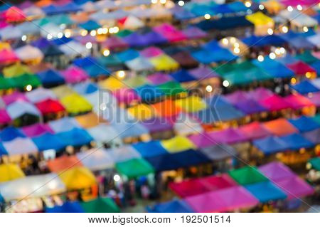 Blurred light aerial view night flea market multiple colour abstract background