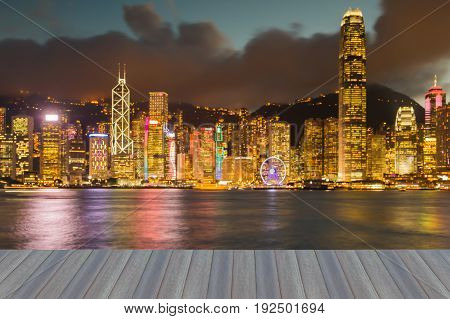 Opening wooden floor Night blurred bokeh Hong Kong business downtown abstract background