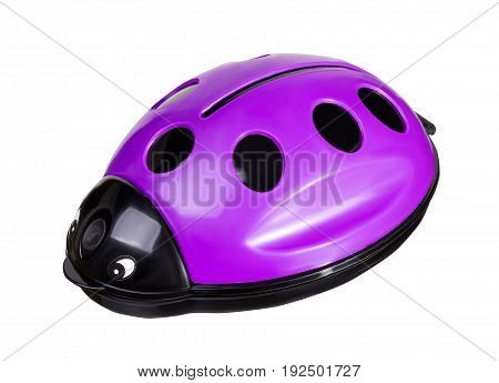 Plastic violet ladybug toy. Brush for cleaning furniture from animal hair isolated on white background