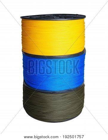 Column of three skeins of synthetic rope of yellow blue and green colors isolated on white background