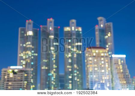 Twilight blurred bokeh office building light night view abstract background