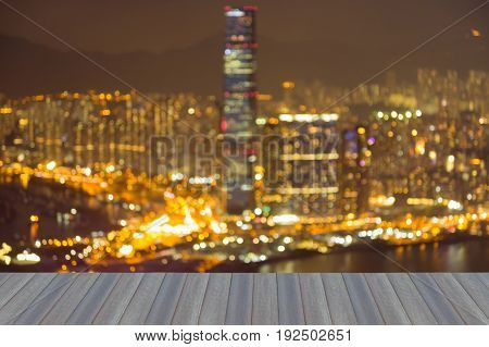 Opening wooden floor Night light blurred bokeh Hong Kong city downtown abstact background