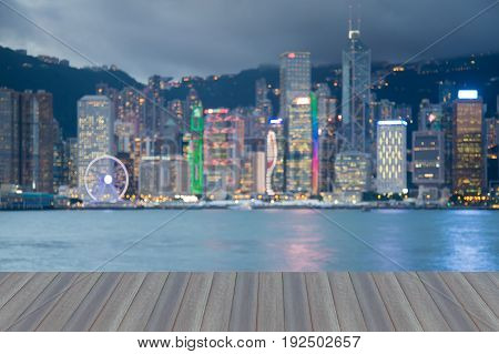 Opening wooden floor Sea front Hong Kong city downtown blurred bokeh light abstract background