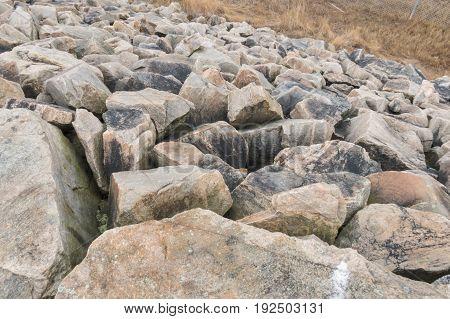 Granite boulders forming hurricane barrier at Egypt Lane in Fairhaven Massachusetts