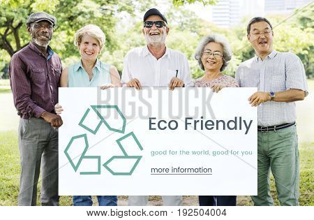 Diverse senior people hold recycle concept card