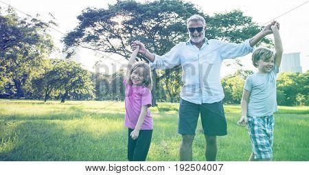 Grandfather Enjoy Grandchildren Outdoors Together