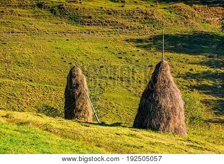 Haystack On The Rural Field On Hillside