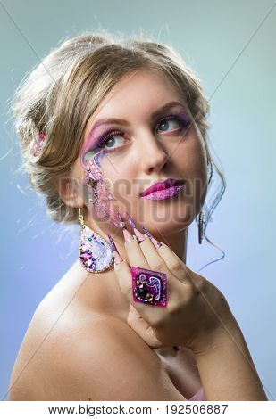 Portrait of beautiful girl with bright makeup