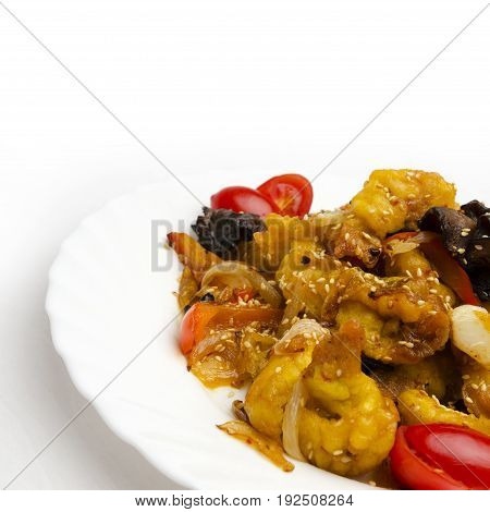 Chicken in sweet and sour sauce, chicken fillet is fried together with vegetables and wood mushrooms
