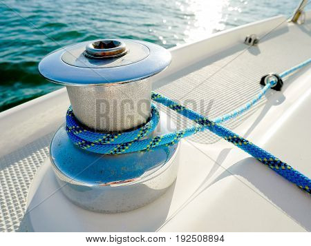 Winch with blue rope on a yacht