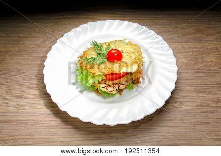 Homemade chicken burger on wood background. Potato pancake chicken burger