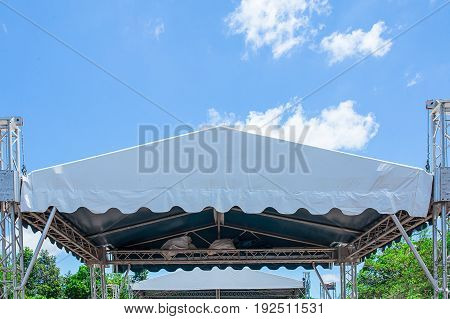 outdoor stage with spot light system and sound equipment