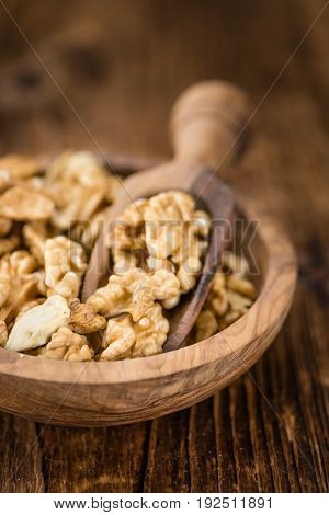 Cracked Walnuts On Wooden Background (selective Focus)