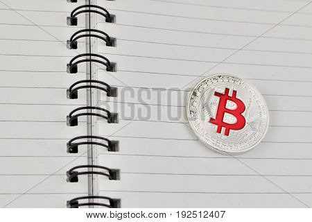Red Bitcoin In Notebook