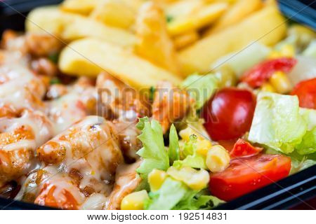 Fresh chicken steak with tomatoes and french fries