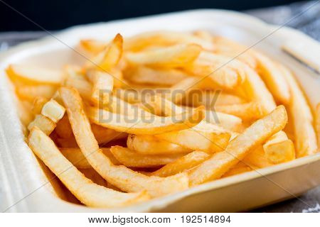 Golden French fries potatoes ready to be eaten