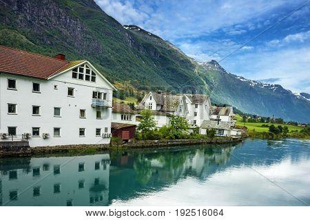 Rural houses village in Olden port, Norway